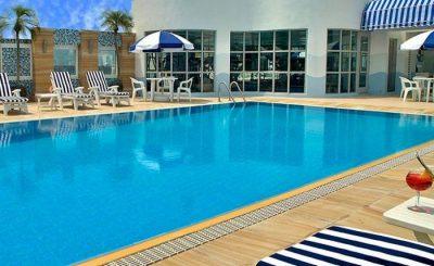 Große Singlereise China - Rooftop Pool Metropart Hotel Kowloo